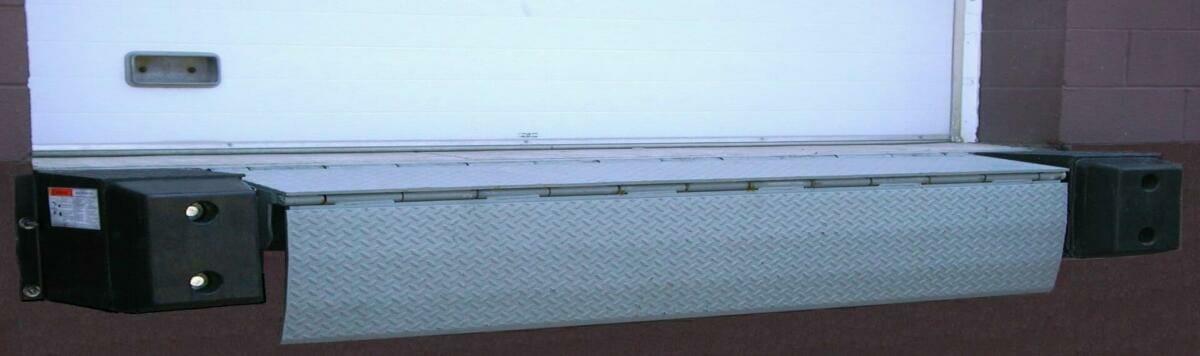 Copperloy® mechanical edge of dock leveler showing truck at dock loading